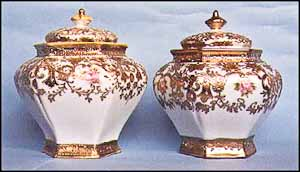 The authentic cracker jar is on the left. Again, note the color difference in both the porcelain and gold.The authentic cracker jar is on the left. Again, note the color difference in both the porcelain and gold.