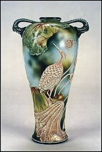 This is an example of the use of Moriage to enhance a hand painted scene. The egret and water plants are of applied Moriage. The backstamp on this vase is the blue maple leaf.