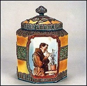 This humidor features a monk smelling roses. This is a decal transfer and not a handpainted scene; however, the elaborate Moriage decoration which covers this piece was hand applied. Portraits are also in demand and highly treasured by collectors.The backstamp on this vase is the blue maple leaf.